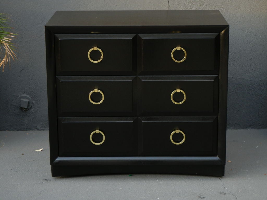 Classic and beautiful. Restored in a tete negre finish with polished brass hardware. We also have the matching tall chest.