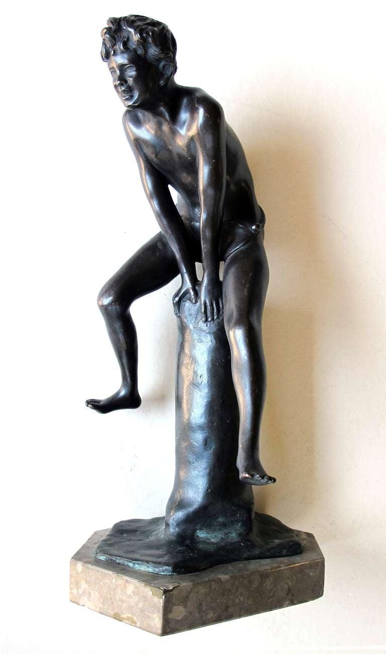 A playful Italian Grand Tour bronze figure of a young male athlete; signed 'Gerente'; depicting a frolicking young man jumping over an upright pommel with body leaning forward and legs outstretched