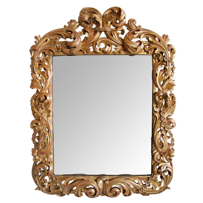 A good quality carved italian baroque giltwood mirror w for Italian baroque mirror