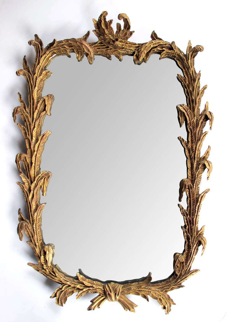 A well carved french rococo style giltwood mirror with for Rococo style frame
