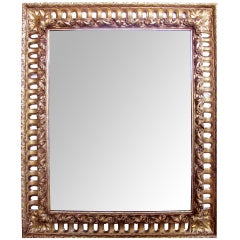 A Richly Carved Italian Baroque Style Giltwood Mirror with Reticulated Frame