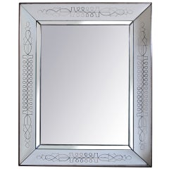 A Fine & Rare French Art Deco Mirror w/Chamfered mirrored frame; by Max Ingrand
