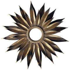 A Large-Scaled and Vibrant French 1940's Gilt-Tole Foliate Starburst Convex Mirror