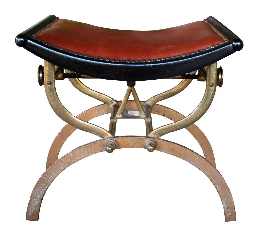 An English Victorian Brass And Iron Piano Stool With