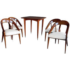 A Stylish French Modernist 1950's Mahogany Game Table With Four Matching Chairs