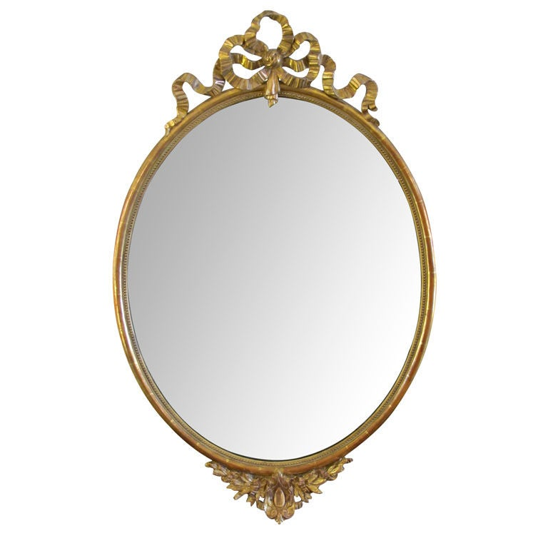 An elegant french napoleon iii oval giltwood mirror with for Elegant mirrors