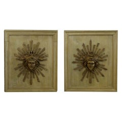 A Unique Pair of French Louis XVI Gilt-Metal Medallions Depicting Mercury now Mounted on Oak Panels