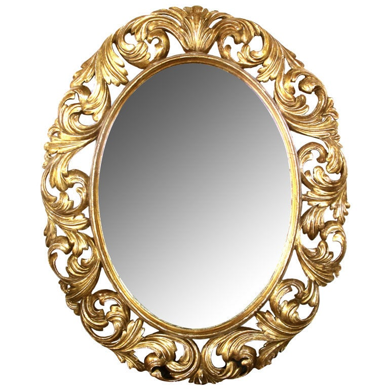 A well carved italian baroque style oval giltwood mirror for Baroque oval mirror