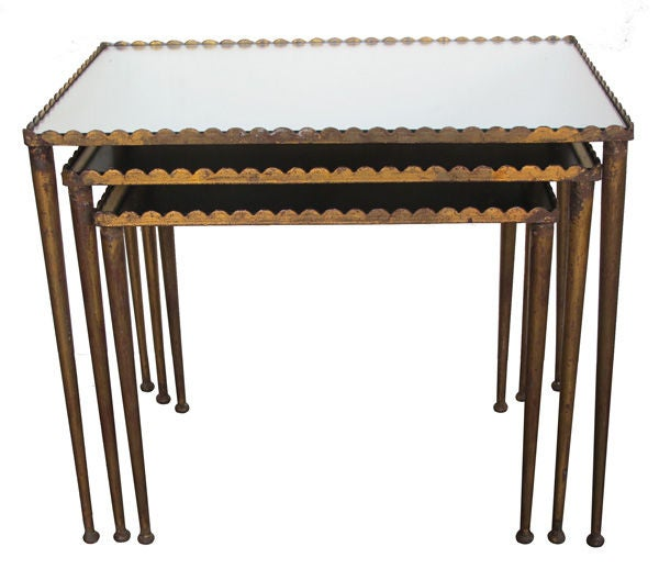 A stylish set of french s gilt metal nesting tables