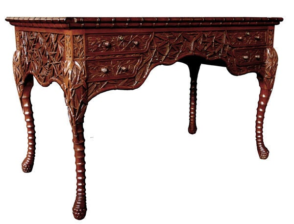 a rarechinese export 4drawer carved teak writing desk with carved bamboo decoration 2
