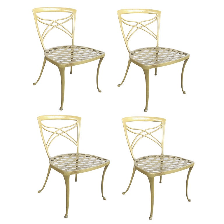 A Set of 4 Brown Jordan 1960's Yellow-Painted Aluminum Garden Chairs