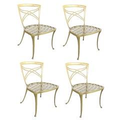 A Set of 4 Brown Jordan 1960's Yellow-Painted Aluminum Garden Chairs