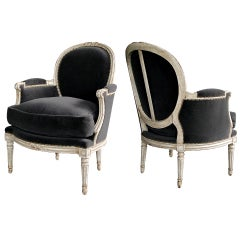 An Elegant Pair of French Louis XVI Style Gray-Painted Oval Back Bergeres