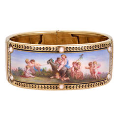 Past Era Mid Victorian Enamel and Pearl Bangle Bracelet with Putti