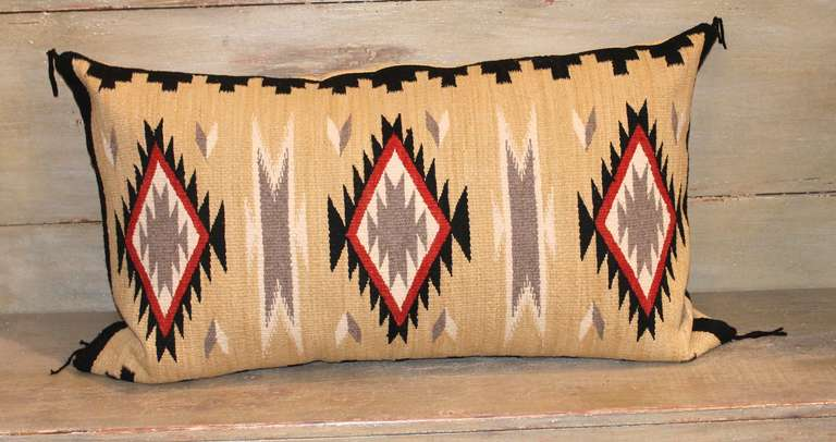 This striking eye dazzler pillow shows vibrant color and intricate detail in the pattern weaving. The backing is in a tan linen with original corner ties. Pillow is down and feather filled with a bottom zipper closure.