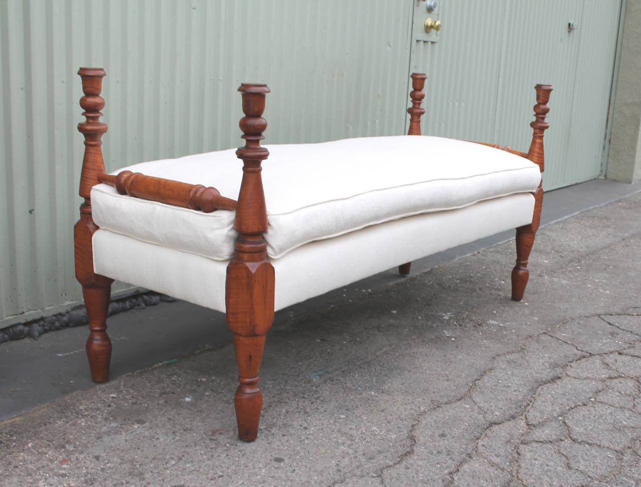 This amazing early 19th century hand-carved daybed in bird's-eye maple is in amazing as found condition. The patina is the very best in this bench frame. This early bed can serve as a bench in a window seat or in front of a bed. The turnings are
