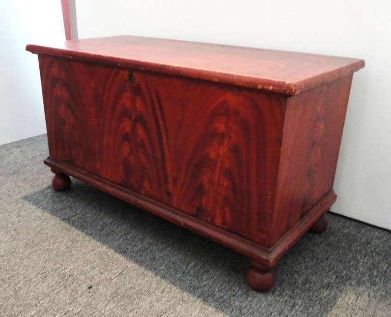 This is a amazing untouched 19thc original paint decorated blanket chest is a small scale size.Wonderful as a coffee table or end of a bed for quilts & blankets.The condition is very good and is dovetailed construction with all original bun feet