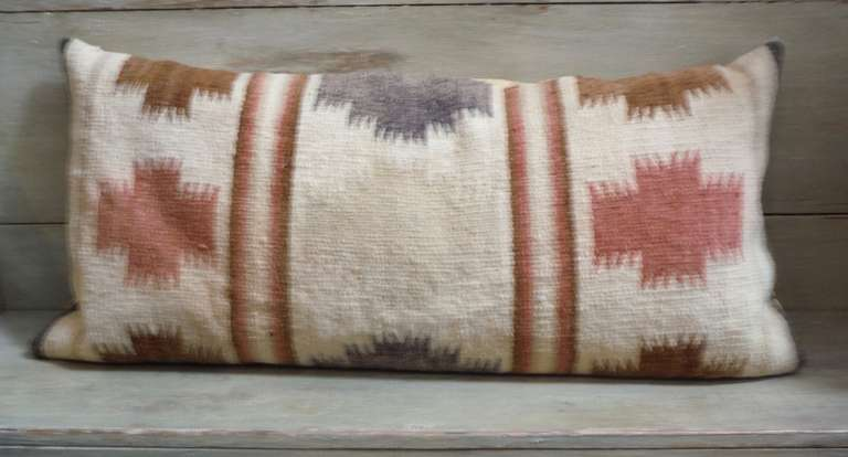 This wonderful muted colors Indian weaving bolster pillow has soft colors with a tan cotton linen backing. The insert is down and feather fill.