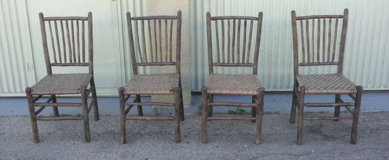Amazing set of four matching original grey painted rustic hickory dinning  chairs .The seats are - Signed Old Hickory Original Grey Painted Hickory Chairs For Sale