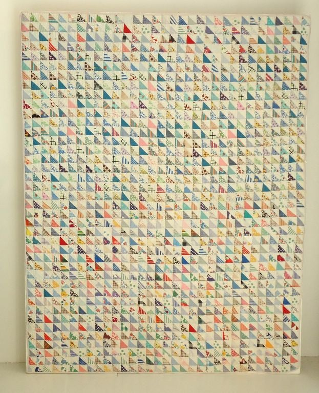 Fantastic small pieced flying geese quilt sewn on linen and mounted on frame. This is a six year youth crib quilt and was on of two quilts from the same family. Smaller of the two babies. Great condition and ready for hanging.