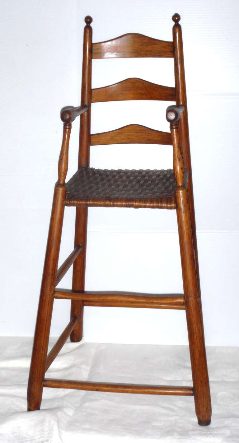 This early 19th century and quite rare hickory and pine height chair is from New England. The style is similar to shaker with fantastic form and splay shape. The seat is probably a second old replaced handwoven splint seat yet is in great condition.