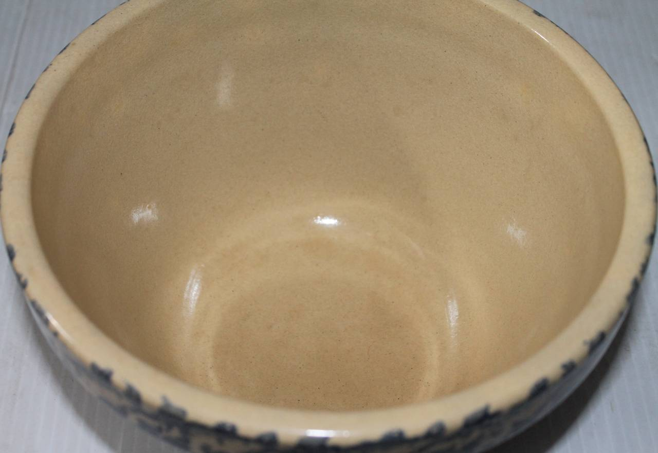 This early 20th century mixing bowl comes from a rare collection of spongeware. This item has been well taken care of and is in pristine condition. There is minor wear that is consistent with its age.