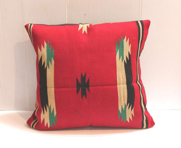 This is a 19th century Germantown Indian weaving made into a cool pillow. These colors are are really punchy and good. This pillow has a black linen back. The insert is down and feather fill.