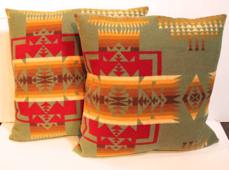 This pair of fantastic Indian design blanket pillows were cut from a Mid-Century pendleton camp blanket. This pair has a dark brown linen backing. Down and feather fill.
