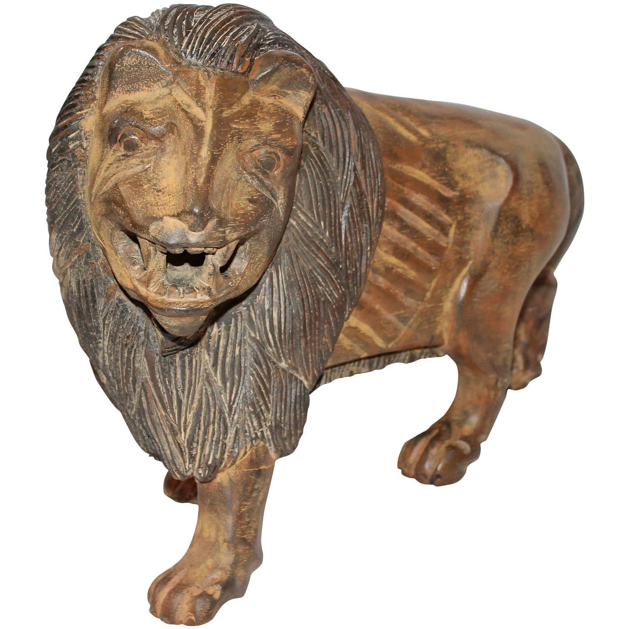 Th century hand carved and painted folky wooden lion at