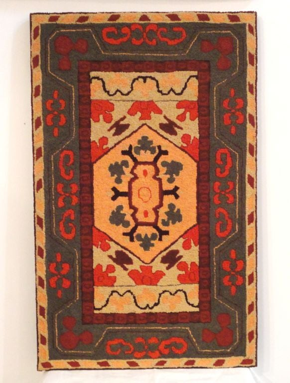 Wonderful variations of PA. Dutch colors and typical of Lancaster Co. colors. Super geometric hand-hooked rug sewn on linen stretcher frame. The colors of salmon, orange, tan and greens. Great wall art. The condition is mint.