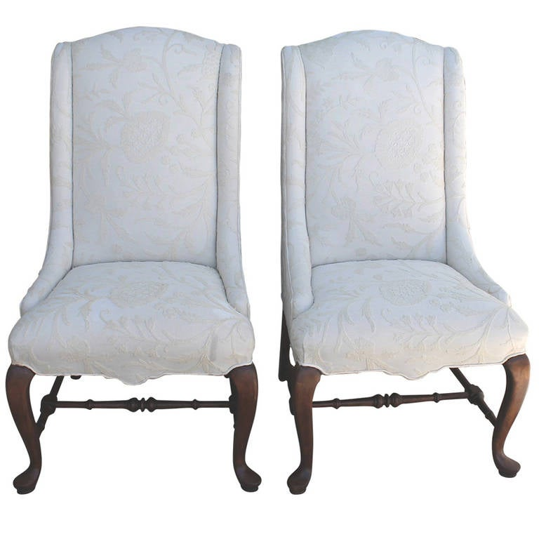 Pair Of Tall Back Wing Chairs Upholstered In Crewel Work Fabric For