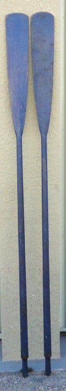 Wonderful Early original blue painted oars from the state of Maine.This wonderful pair of boat oars have the best patina and a crackle surface .Very hard to find in this color and surface.The condition is great.