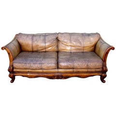 Monumental Distressed Leather and Carved Wood Sofa