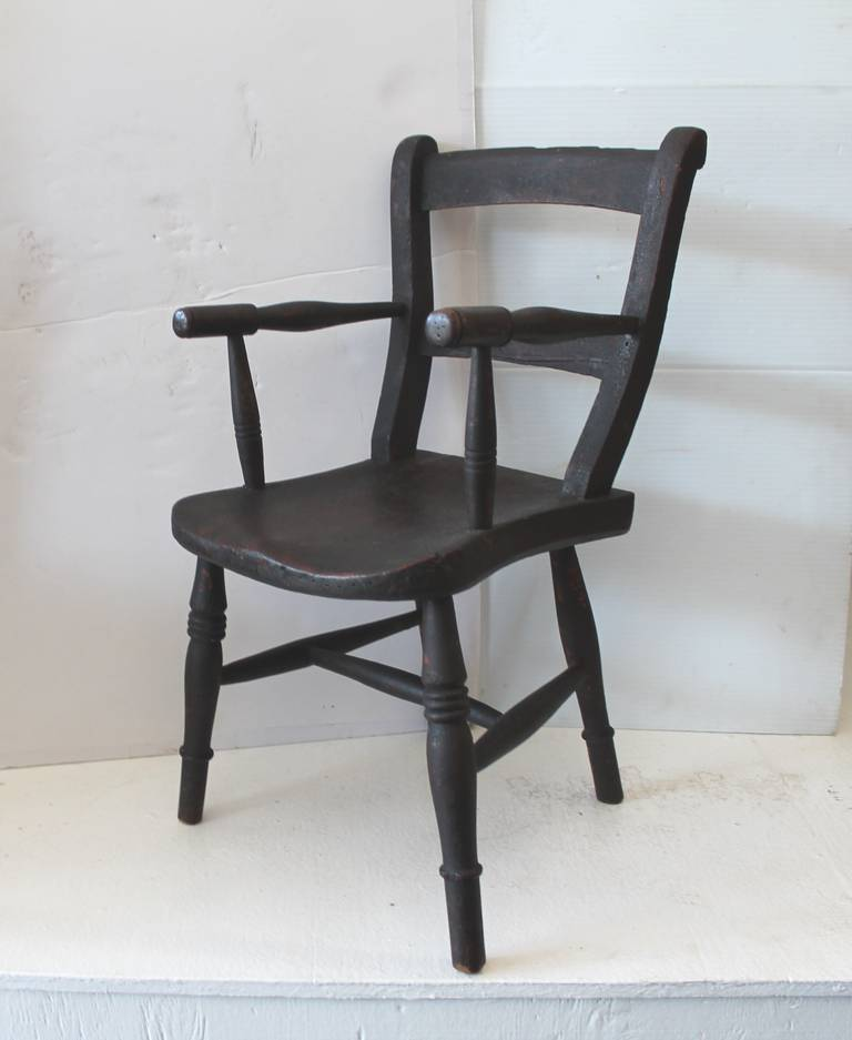 This amazing untouched surface is to beat the band. It was found in  New England & the  chair is in great condition and has wonderful form. It has been well love and used.The wear is consistent with age and use.