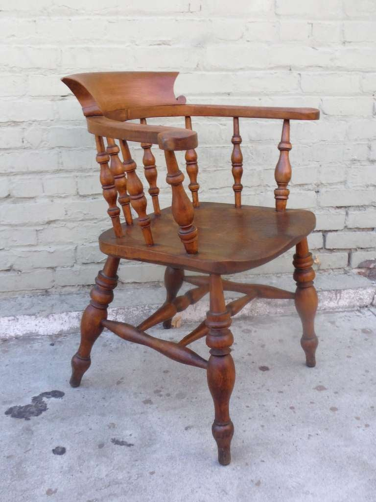 This outstanding example of an untouched, all original pub chair dates to late 19th century England. With a rich dark finish and patina, this chair is sturdy and strong with great character. As these chairs were originally designed to encourage long