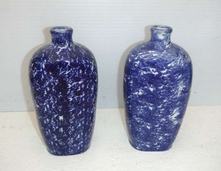 These bottles are most unusual for blue and white sponge ware pottery. They are also both signed made in Belgium. They are in pristine condition. Sold as a pair.