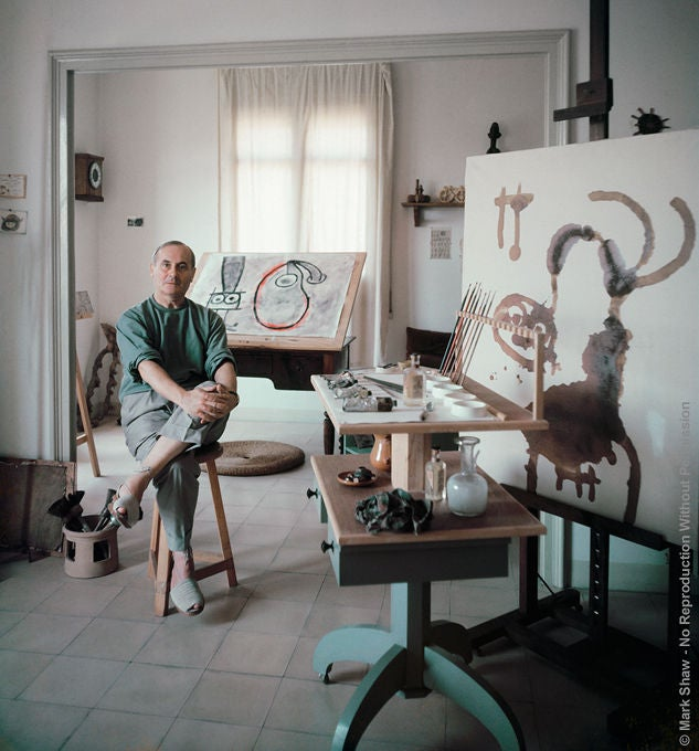 Captured by legendary photographer Mark Shaw for a 1955 story in LIFE Magazine is a portrait of Joan Miro at work in his tiny Barcelona studio. This photo was an outtake from that session and has not been seen by the public previous to now. Due to