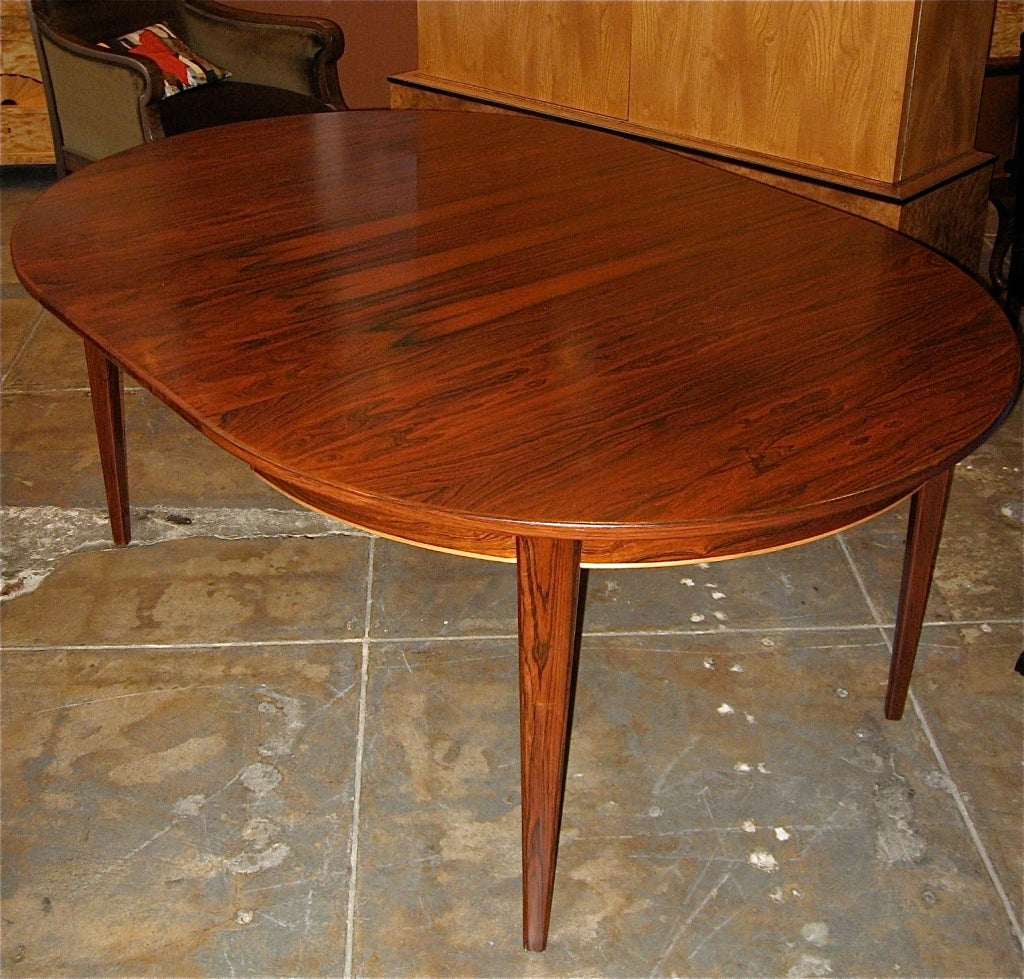 Danish Mid-Century Modern Extendable Rosewood game/dining Table. Table has two matching rosewood leaves. two  Table round is 47.5