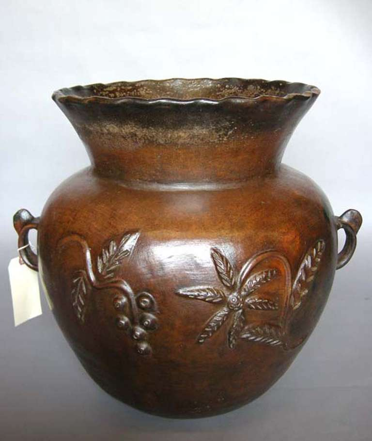 Antique ceramic florero (water storage pot) from Guatemala. Beautiful floral relief all around. In very good condition considering its age. Handles are intact.