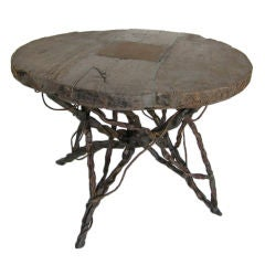 Antique Wooden Wheel and Iron Table