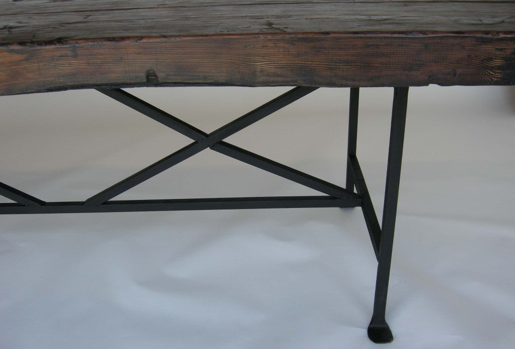 Reclaimed wood dining table with hand forged iron base for for Forged iron table base