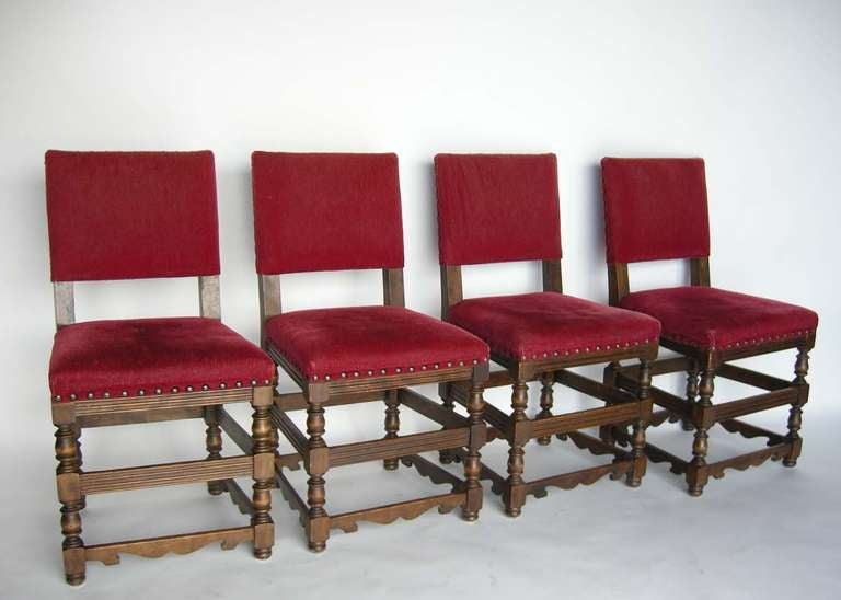 Four antique chairs with original red velvet upholstery and nail heads