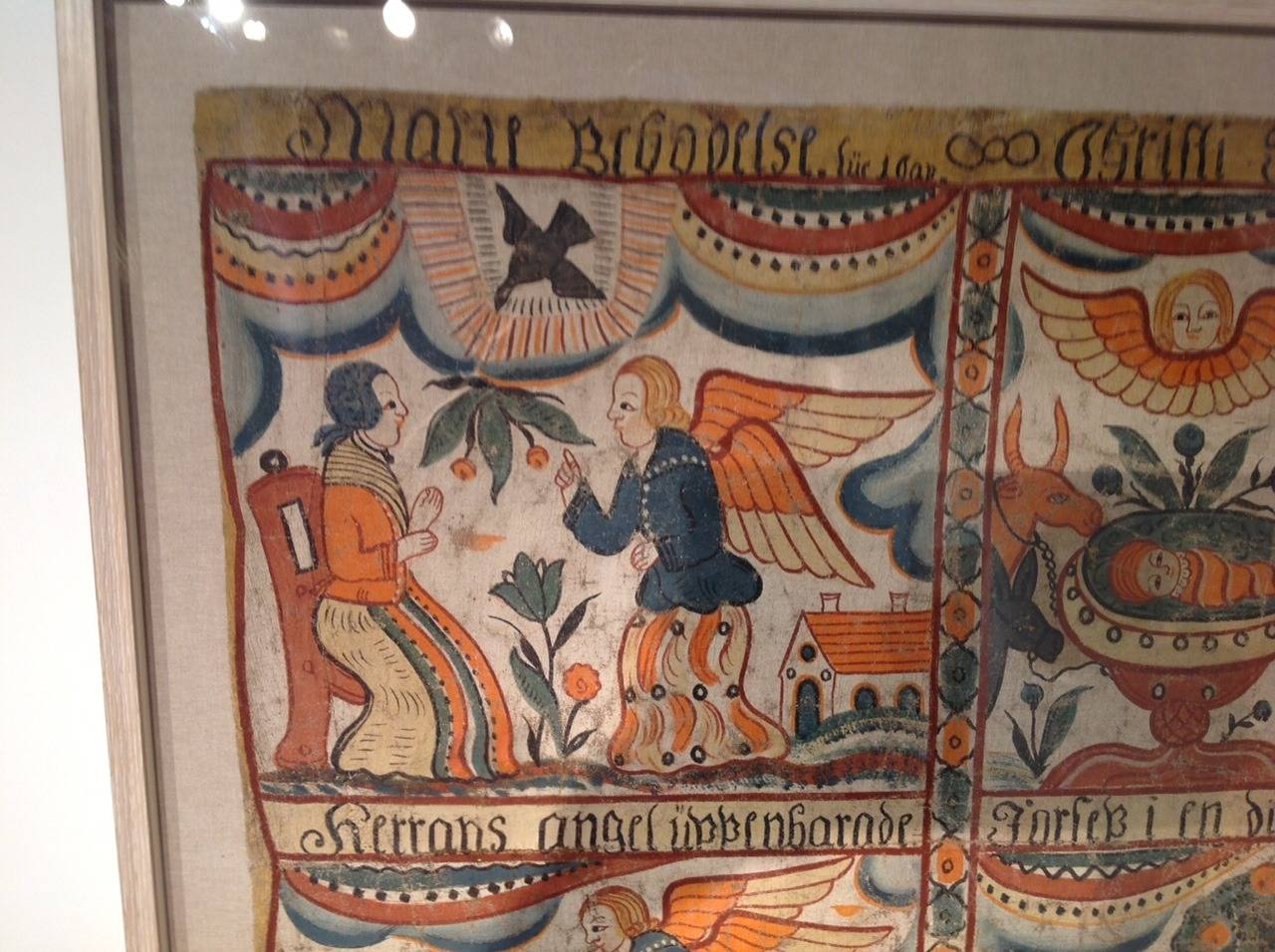 Outstanding early 19th century Swedish Folk Art mural (or bonad; also referred to as a kurbitz or kurbits) depicting the Annunciation, the Nativity, the Proclamation and Flight into Egypt, all the figures dressed in 18th century Swedish costume and