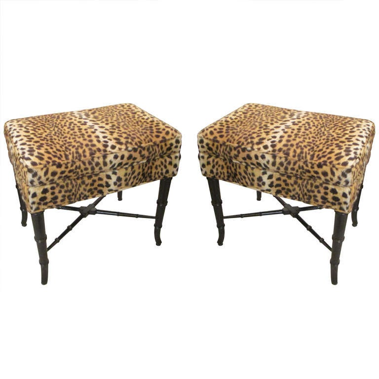A pair of faux bamboo benches upholstered in leopard print Leopard print bench