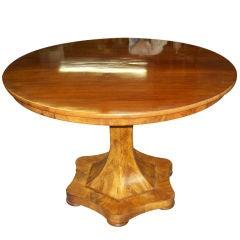 A Biedermeier Mahogany Center Table on Pedestal Base