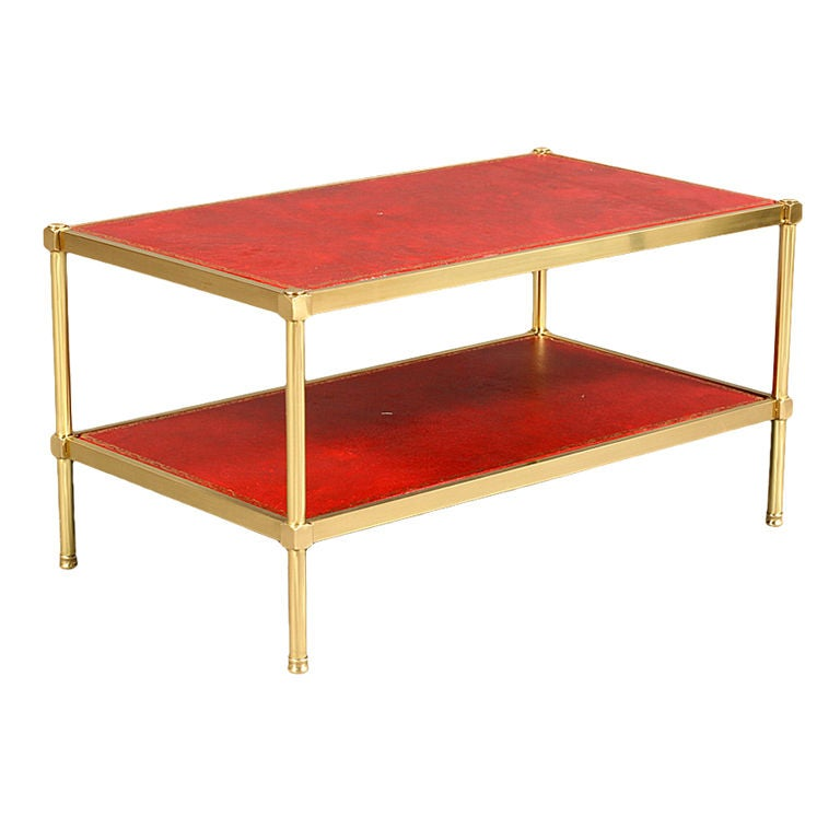 this a brass two tiered leather top coffee table is no longer