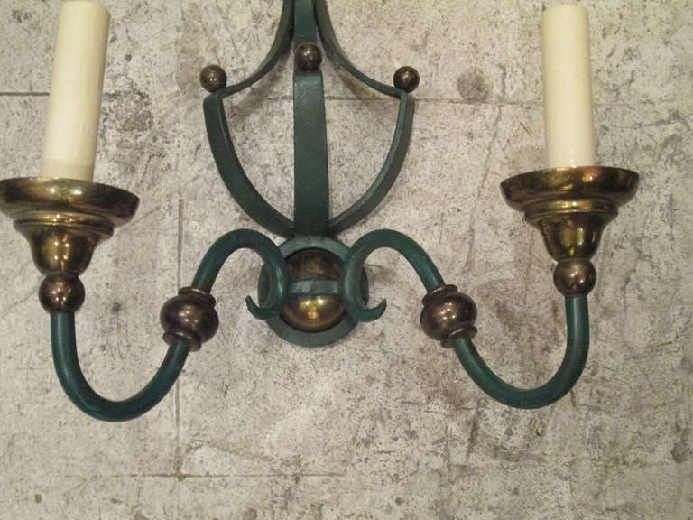 A Whimsical Pair Of Painted Iron And Brass Sconces For Sale at 1stdibs