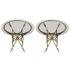 A Pair Of Brass Arrow Tables With Smoked Glass Tops
