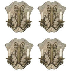A Set Of Four Hand-etched Mirrored Sconces