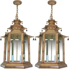 A pair of  pagoda-shaped, hand-painted tole fixtures